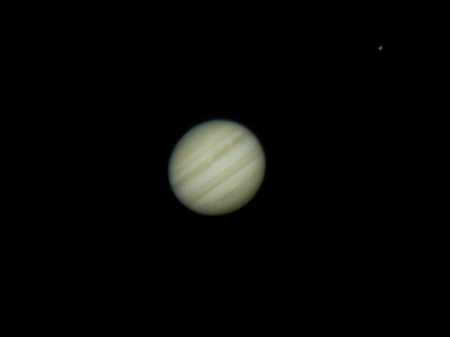 The highlight of the evening for me: Jupiter and its moons. Three of the four Galilean moons were visible in the eyepiece, but this photo only shows one: Io, on the upper right.