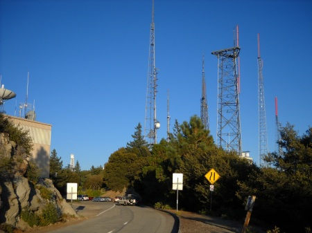 The antenna forest outside the observatory entrance. The top of the solar telescope tower is visible in the distance on the left.