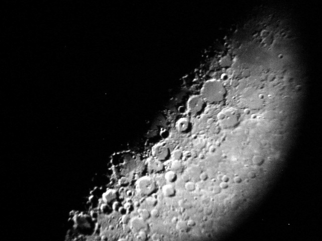 This shot is from a few nights previous to the last one. Now the backward comma formed by Ptolemaeus, Alphonsus, and Arzachel is right on the terminator, just slightly above and right of center.