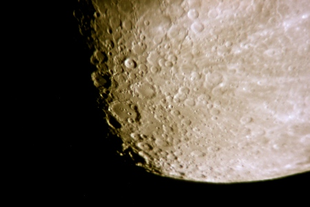 The bright crater above and left of center is Tycho--note the rays of ejecta that point back to this young, well-defined crater. Below Tycho is the much larger, worn Clavius, with a nice arc of craterlets of decreasing size on its floor.