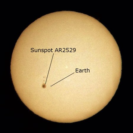 The diameter of the sun is 109 times that of Earth. Here's how Earth would compare to the current large sunspot if they were side-by-side.